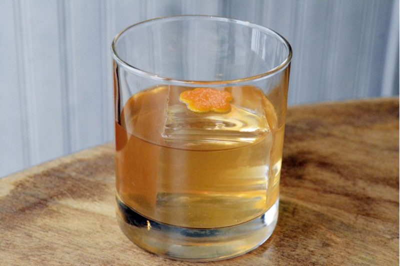 Lyon Distilling rum cocktail with orange peel garnish and ice cube